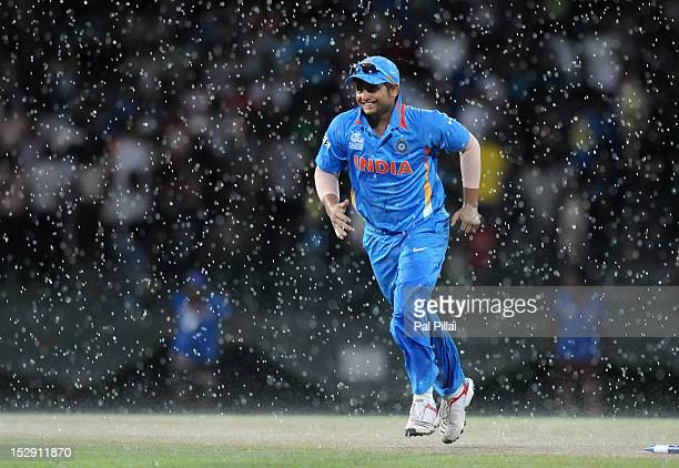 Suresh Raina of India runs back to the pavilion as it starts raining during the super eight match between Australia and India held at R Premadasa...