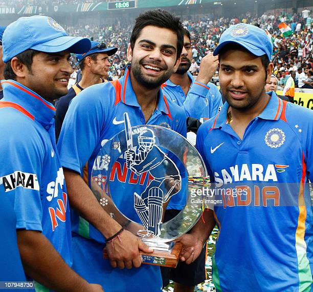 Suresh Raina Virat Kohli and Rohit Sharma of India celebrate with the winners trophy after the Standard Bank Pro20 international match between South...