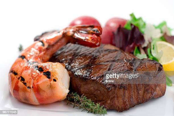 surf and turf seafood dinner on plate - seafood stock pictures, royalty-free photos & images
