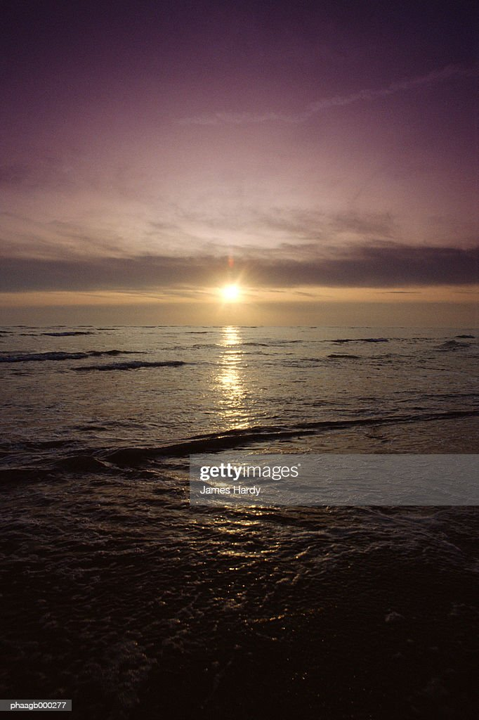 Surf at sunrise : Stock Photo