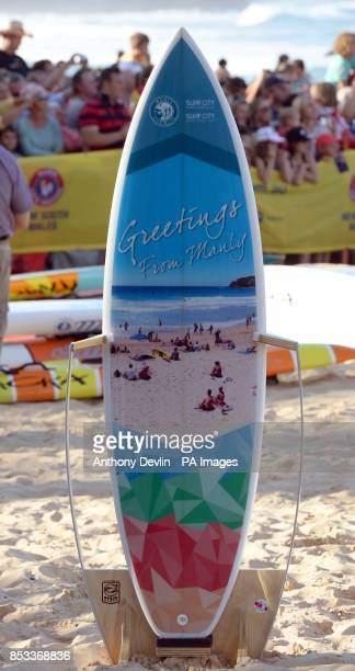 A surf board presented to the Duke and Duchess of Cambridge as they view a surf lifesaving display and meet volunteers at Manly Beach Sydney during...