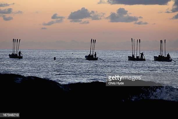 Surf boats perform a sea burial during the ANZAC dawn service at Currumbin Surf Life Saving Club on April 25 2013 in Gold Coast Australia Veterans...
