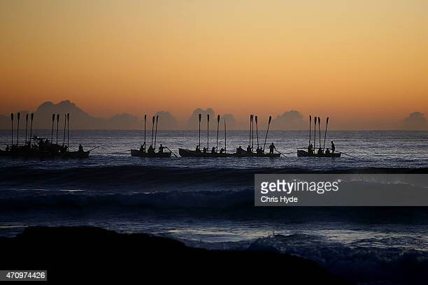 Surf boats perform a sea burial during the Currumbin RSL dawn service on April 25 2015 in Currumbin Australia Australians are celebrating the...