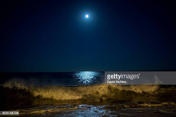 Surf breaks as the moon makes its closest orbit to the Earth since 1948 on November 14 2016 in Redondo Beach California The socalled supermoon...