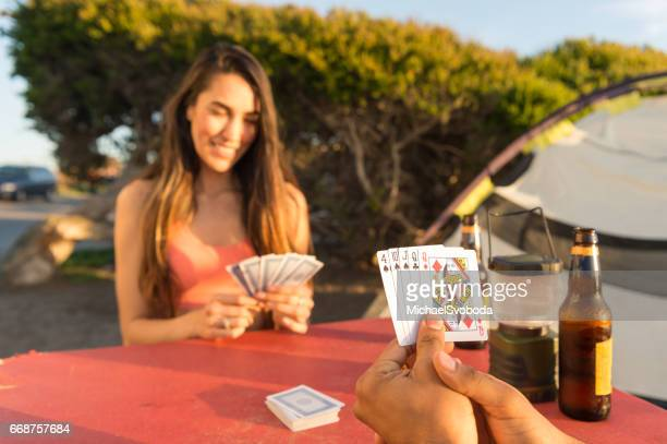Surf Couple Playing Cards In Camp