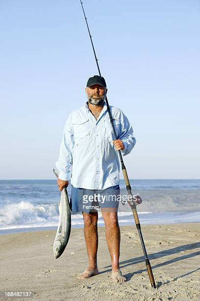 Surf fisherman with a bluefish