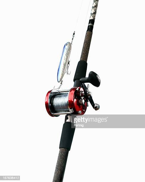 Surf fishing rod, reel and lure on white
