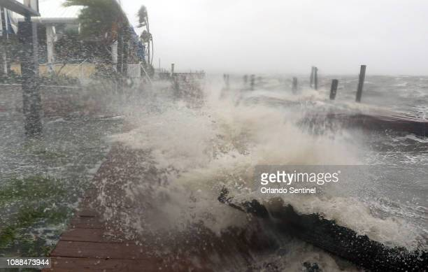 Surf from the Banana River crashes up on a dock at Sunset Grill Thursday Oct 7 2016 in Cocoa Beach as the Category 4 Hurricane Matthew hit...