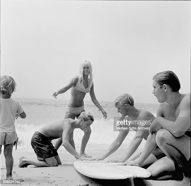 Surf Girl Champ Mary Kays 18 get plenty of help from boys at Laguna Beach California