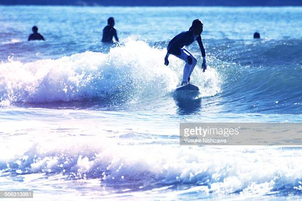 surf girl - yusuke nishizawa stock pictures, royalty-free photos & images