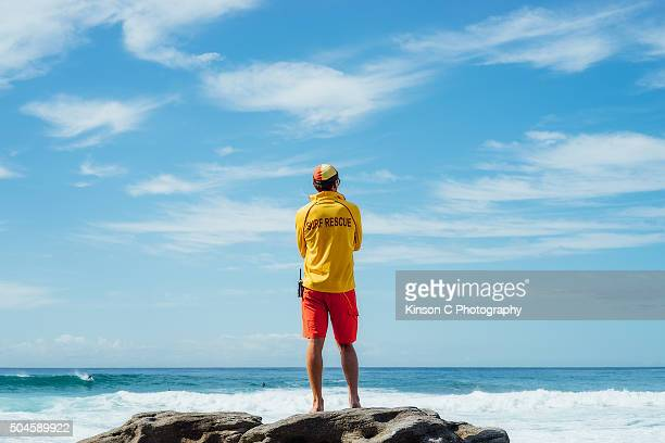 surf guard overlooking the ocean - lifeguard stock pictures, royalty-free photos & images