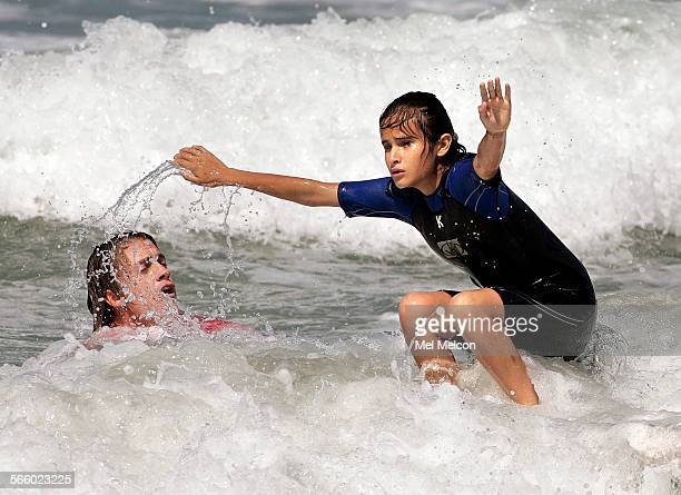 Surf instructor Adam May teaches Lupita Salazar who is totally blind how to surf at Manhatten Beach on August 6 2008 Salazar was one of thirteen...