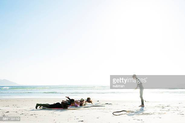Surf Instructor Giving Surf Lessons On The Beach