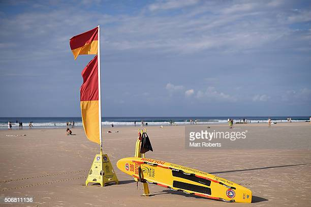 Surf life saving flags and rescue board are seen at Rainbow Bay on January 26 2016 in Gold Coast Australia Australia Day formerly known as Foundation...
