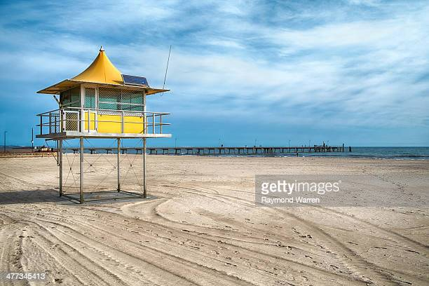 CONTENT] A surf Life saving tower on an almost deserted Glenelg Beach in Adelaide South Australia