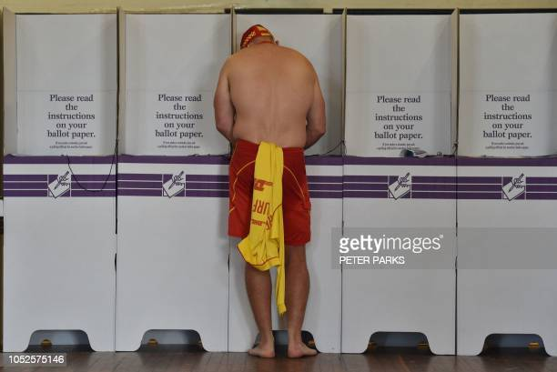 TOPSHOT A surf lifesaver casts his ballot in the Wentworth byelection in Bondi Beach in Sydney on October 20 2018 Australia's embattled conservative...