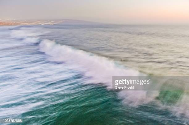 surf motion blue - hermosa beach stock pictures, royalty-free photos & images