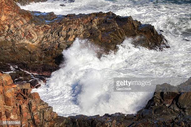 Surf pounding a rocky headland