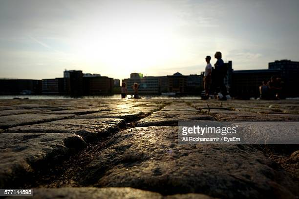 surface level cobblestone near waters edge - oresund region stock photos and pictures