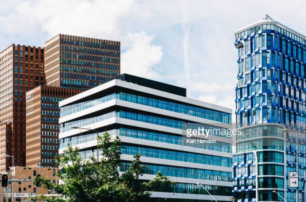 a surface level daytime view of amsterdam's business district - stock photo - amsterdam stock pictures, royalty-free photos & images