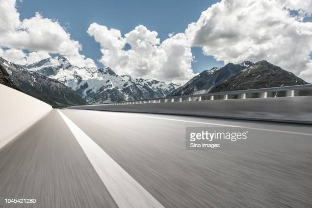 surface level image of highway in mountains, new zealand - image stock pictures, royalty-free photos & images