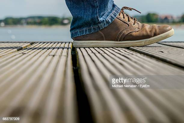 Surface Level Of A Man Walking On Pier
