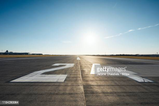 surface level of airport runway - airfield stock pictures, royalty-free photos & images