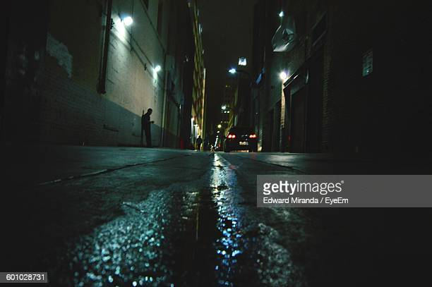 Surface Level Of Alley Amidst Buildings At Night