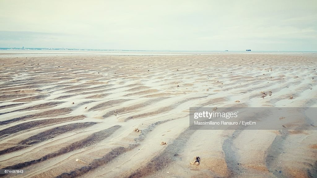 Surface Level Of Beach Against The Sky : Stock Photo