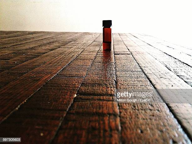 Surface Level Of Bottle On Wooden Table
