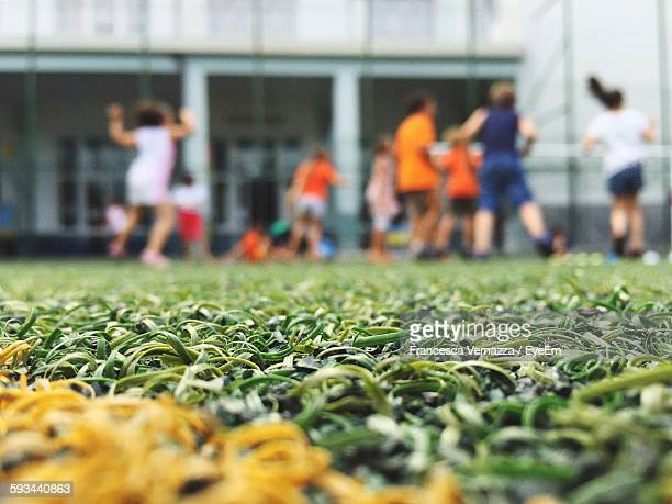 surface level of ground with blurred team in background - fake stock pictures, royalty-free photos & images