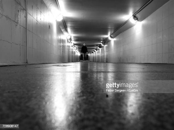 surface level of man walking in illuminated underground - fedor stock pictures, royalty-free photos & images