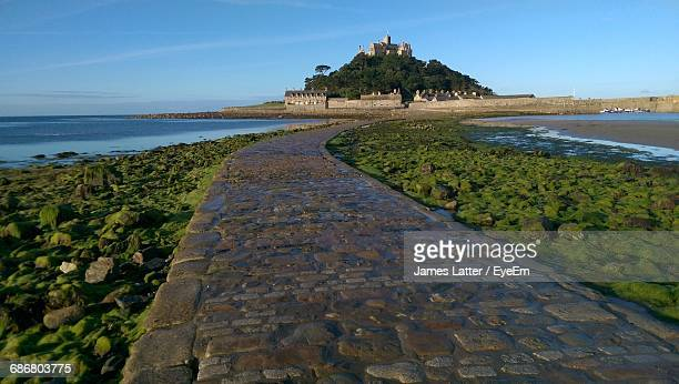 surface level of pathway against calm sea - latter stock pictures, royalty-free photos & images