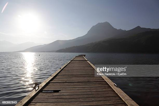 surface level of pier on sea - embrun stock photos and pictures