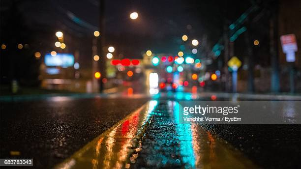 surface level of road at night - wet stock pictures, royalty-free photos & images