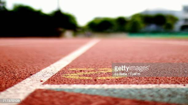 surface level of running track - track and field stadium stock pictures, royalty-free photos & images