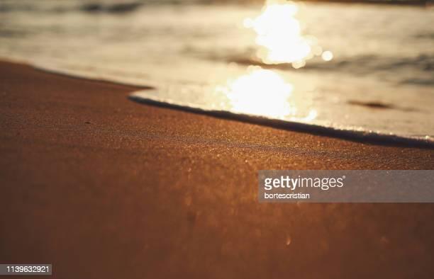 surface level of sand at beach during sunset - bortes imagens e fotografias de stock
