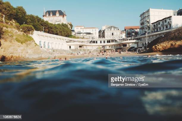 surface level of sea against buildings - biarritz stock pictures, royalty-free photos & images