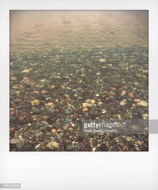 surface level of stones in sea - frank swertz stockfoto's en -beelden