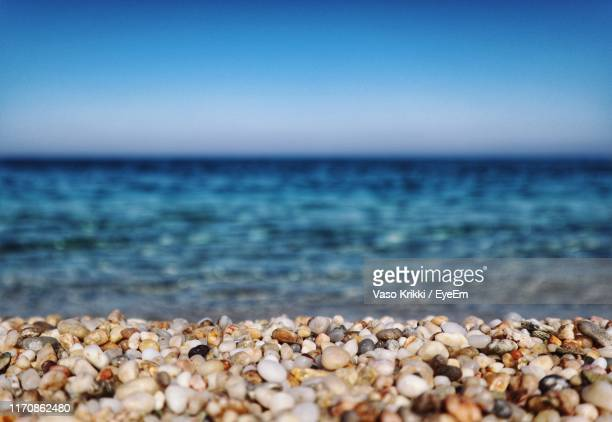 surface level of stones on beach against clear sky - vaso stock pictures, royalty-free photos & images
