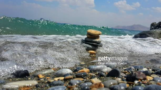 surface level of stones on beach against sky - pebble beach california stock pictures, royalty-free photos & images