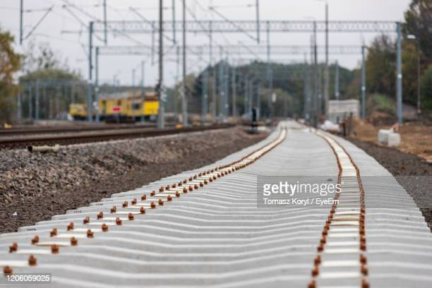 surface level of train on railroad track - poland stock pictures, royalty-free photos & images