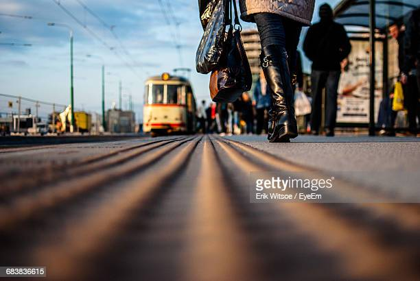 Surface Level Of Woman Walking By Tramway