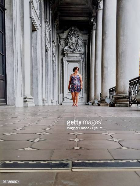 Surface Level Shot Of Woman Standing In Corridor
