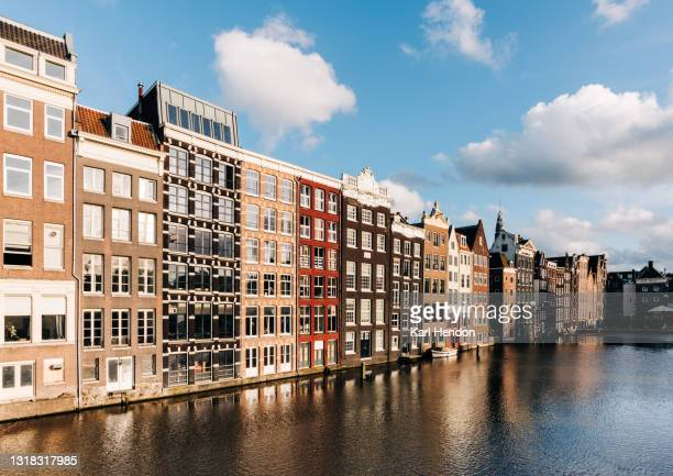 a surface level sunset view of amsterdam - stock photo - amsterdam stock pictures, royalty-free photos & images