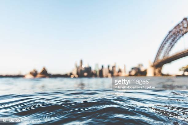 surface level view of calm sea in sydney harbour - sydney harbour stock pictures, royalty-free photos & images
