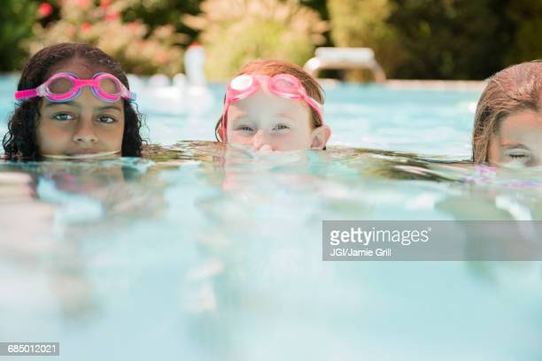 93d64a0be85 Mixed Race Girl Swimming Underwater Stock Photos and Pictures