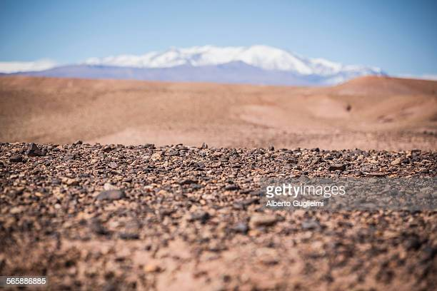 surface level view of gravel field and remote desert - differential focus stock pictures, royalty-free photos & images