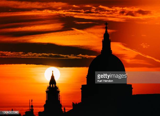 a surface level view of st.paul's cathedral silhouetted at sunrise - stock photo - city life stock pictures, royalty-free photos & images
