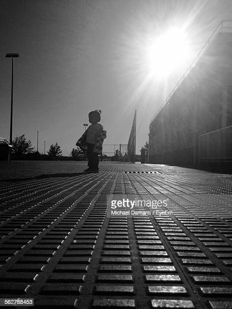 surface level view of toddler standing on paving stone walkway in sunlight - michael damanti fotografías e imágenes de stock